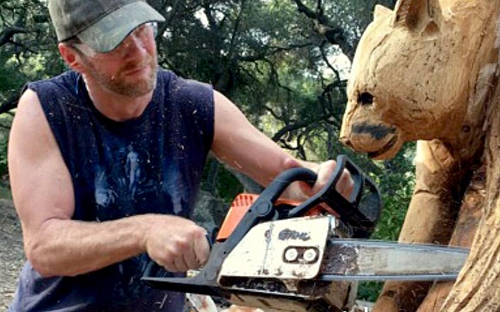 La chainsaw carving creating fine art with a